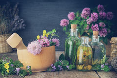 Bottles of tincture or infusion of healthy herbs. Bottles of tincture or infusion of healthy herbs, healing herbs on table. Herbal medicine royalty free stock photography