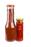 Bottles with tomato ketchup and chili peppers Royalty Free Stock Image