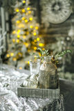 Bottles and tree toys in vintage Christmas decorated room Royalty Free Stock Photography