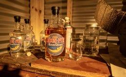 Bottles of Moonshine. Bottles of vanilla moonshine at the Three Boys Farm Distillery in Central Kentucky stock photography