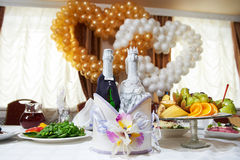 Bottles vine in the costumes of groom and bride royalty free stock photos