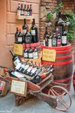 Bottles of Vino Nobile, the most famous wine from Montepulciano, on display outside a winery, on July 21, 2017, in Montpulciano,. Bottles of Vino Nobile, the Royalty Free Stock Image