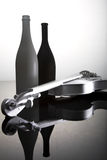 Bottles and violin Stock Image
