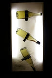 Bottles on wall. Three bottles on the wall background at winery stock photography