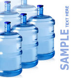 Bottles of water. Big plastic bottles for potable water isolated on a white background Stock Photos