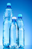 Bottles of water on blue Stock Photos