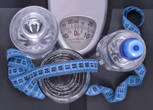 Bottles of water, glass of water and measuring tape Royalty Free Stock Photo