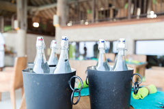 Bottles of water in ice bucket at hotel restaurant. Drinks, thirst, refreshment and summer resort concept - bottles of water in ice bucket at hotel restaurant Stock Photo