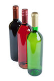 Bottles of white, pink and red wine Royalty Free Stock Images