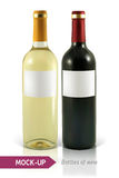 Bottles of white and red wine Royalty Free Stock Photography