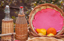 Bottles and wicker baskets Royalty Free Stock Image