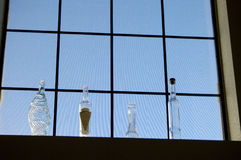 Bottles in a window 2 Stock Images
