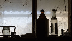 Bottles are on a window. In a barn Royalty Free Stock Image
