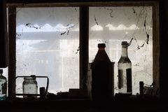 Bottles are on a window in a barn.  royalty free stock photos