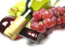 Bottles of wine. Two bottles of wine and some grapes Stock Photography