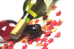 Bottles of wine and autumn leaves stock image