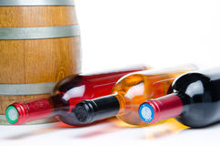 Bottles of wine with a cask Stock Images
