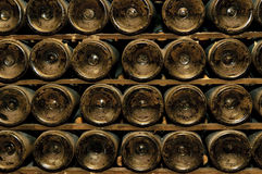 Bottles in wine cellar Stock Photography