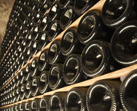 Bottles of wine in a cellar Royalty Free Stock Photo