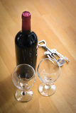 Bottles of wine with a corkscrew on wood table Royalty Free Stock Photography