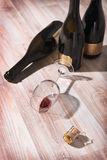 Bottles with wine and empty wine glass Stock Image