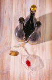 Bottles with wine and empty wine glass royalty free stock images
