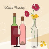 Bottles of wine and flowers. Royalty Free Stock Photo