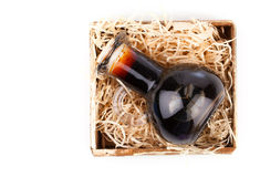 Bottles of wine or herbal syrup, in wooden box, Royalty Free Stock Photo