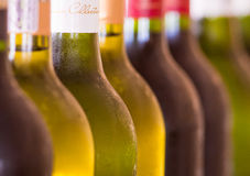 Bottles of Wine. Many bottles of wine stacked closely together in a bar restaurant enviroment Stock Photos