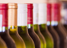 Bottles of Wine. Many bottles of wine stacked closely together in a bar restaurant enviroment Royalty Free Stock Image