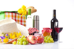 Bottles of wine and Picnic basket with delicious food Royalty Free Stock Photography