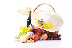 Bottles of wine and picnic basket with delicious food Royalty Free Stock Images
