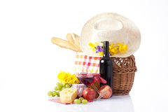Bottles of wine and picnic basket with delicious food Stock Photos