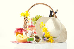 Bottles of wine and picnic basket with delicious food. In white Royalty Free Stock Photography