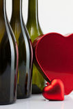 Bottles of wine and red heart Stock Images
