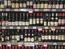 Bottles of wine. Wine bottles for sale on super market shelves Stock Photos