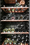 Bottles of wine on the shelves royalty free stock photo