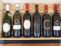 Bottles of wine on the stand Royalty Free Stock Photography