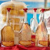 Bottles of wine on table. Different bottles of white wine on table, closeup photo Stock Photos