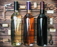 Bottles of wine and various accessories Stock Photos