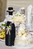 Bottles with wine on wedding table Stock Photos