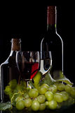 Bottles of wine with wineglasses. Isolated on black royalty free stock image