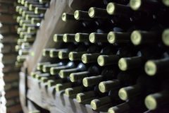 Bottles of wine on a wooden shelf Stock Photo