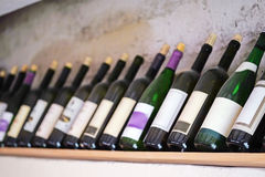 Bottles of  wine on a wooden shelf in the restaurant Royalty Free Stock Image
