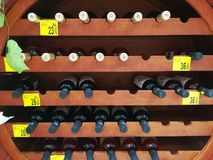 Bottles of wine in wooden shelves Royalty Free Stock Image