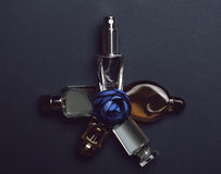 Bottles of woman perfume on dark background. Royalty Free Stock Image