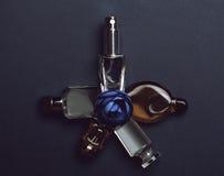 Bottles of woman perfume on dark background. Royalty Free Stock Image