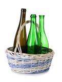 Bottles in wood basket Stock Images