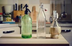 Bottles on wooden table on kitchen  background. Vintage bottles on wooden table on kitchen  background Stock Photography