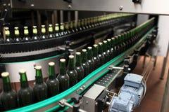 Bottling line. Details of bottling line at a brewery Stock Photos